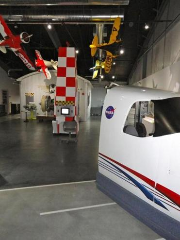 Scale models of aircraft hang inside the Aviation Museum of New Hampshire's new wing.